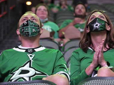 Rupert Munro, 33, and Whitney Munro, 38, of Coppell, sport Dallas Stars face coverings as they watch the Dallas Stars against the Las Vegas Golden Knights in game 2 of the NHL Western Conference Final, Sept. 08, 2020 during a watch party at the American Airlines Center in Dallas. Ben Torres/Special Contributor
