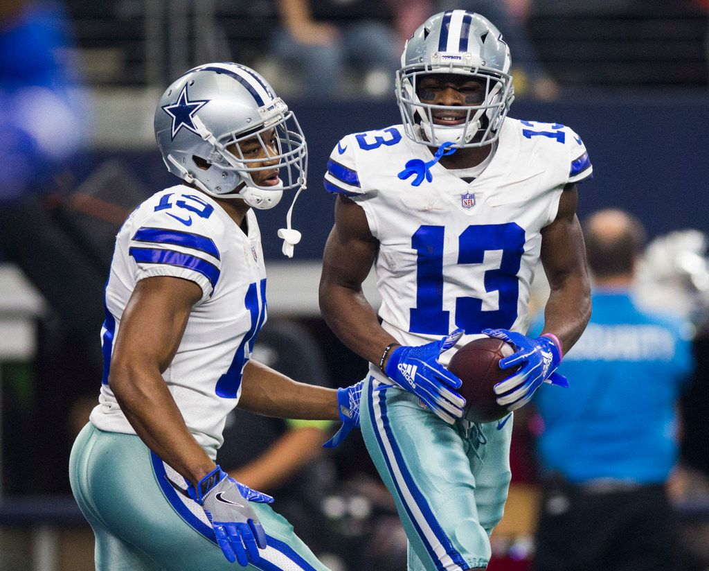 Dallas Cowboys wide receiver Amari Cooper (19) celebrates with wide receiver Michael Gallup (13) after a touchdown during the third quarter of an NFL game between the Dallas Cowboys and the Tampa Bay Buccaneers on Sunday, December 23, 2018 at AT&T Stadium in Arlington, Texas. (Ashley Landis/The Dallas Morning News)