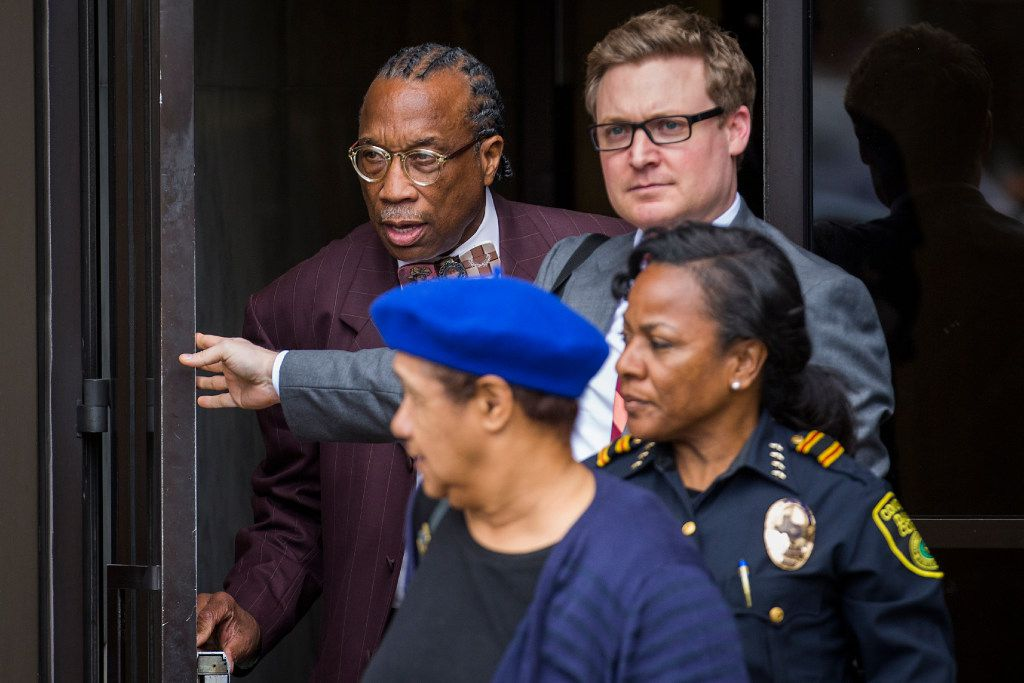 Price, with attorney Chris Knox (right), was found not guilty of seven counts. The jury deadlocked on four other counts against him. (Smiley N. Pool/Staff Photographer)