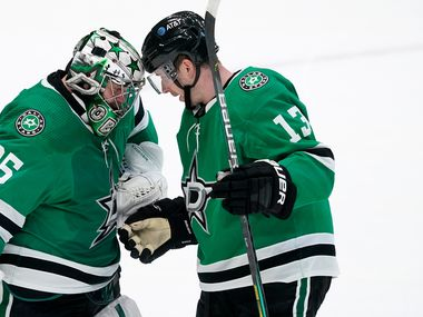 Dallas Stars goaltender Anton Khudobin (35) and defenseman Mark Pysyk (13) celebrate their win over the Florida Panthers in an NHL hockey game in Dallas, Saturday, April 10, 2021.