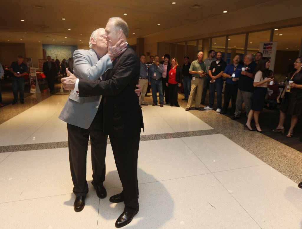 Former Southwest Airlines CEO Herb Kelleher kisses current CEO Garry Kelly prior to a press conference as the Wright Amendment ends and Dallas Love Field is opened to nonstop flights on Oct. 13, 2014.