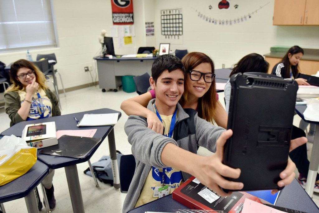 Student Mohammad Faroz took a selfie with math teacher Thuy Nguyen with his new tablet received through the Sprint 1Million Project in 2016 at Conrad Global Collegiate Academy in Dallas.