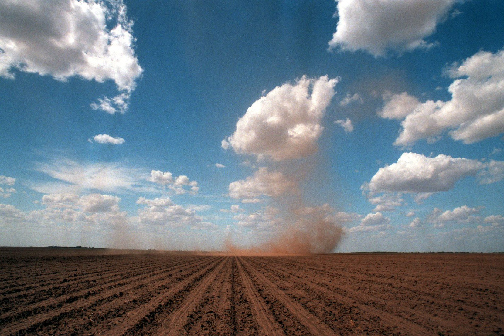 A dust devil rolls across a field near Sweetwater, an area commonly referred to by locals as The Big Country.