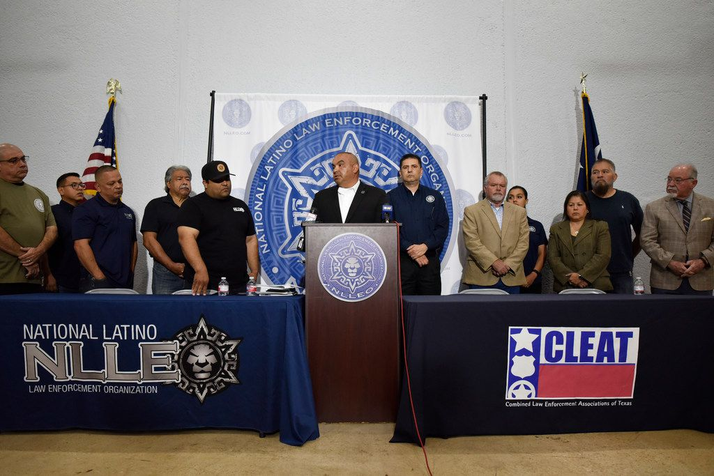 George Aranda, speaking, director of the National Latino Law Enforcement Organization, calls for a vote of no confidence in the leadership of Dallas Chief of Police Renee Hall during a press conference at the headquarters of the National Latino Law Enforcement Organization in Dallas. Ben Torres/Special Contributor