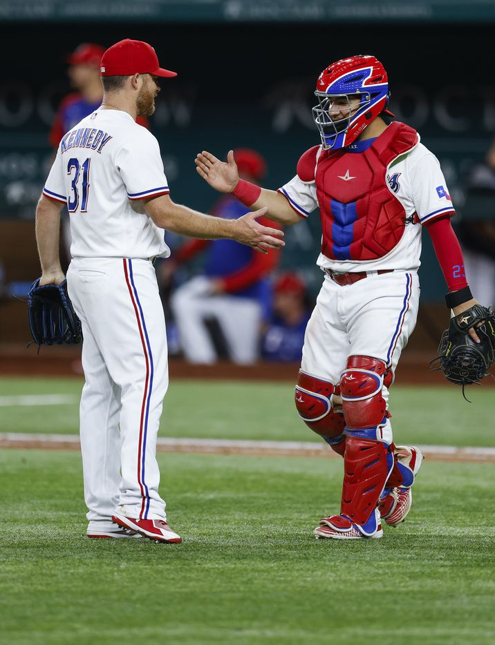 Texas Rangers relief pitcher Ian Kennedy (31) and catcher Jose Trevino (23) celebrate an 8-3 win over the Oakland Athletics after a baseball game in Arlington, Monday, June 21, 2021. (Brandon Wade/Special Contributor)