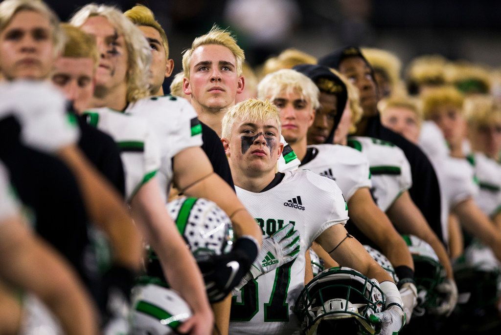Southlake Carroll football players listen to the national anthem before a Class 6A Division I area-round high school football playoff game between Southlake Carroll and DeSoto on Friday, November 22, 2019 at AT&T Stadium in Arlington. (Ashley Landis/The Dallas Morning News)