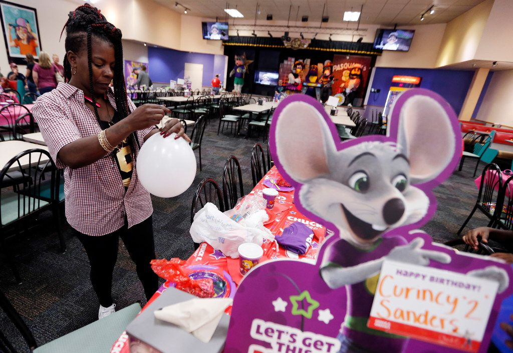 Iris Thomas blows up balloons for her grandson's second birthday party at a Chuck E Cheese location in Arlington, Saturday, August 26, 2017. The Irving-based parent company of Chuck E Cheese's is testing locations without the chain's signature animatronic characters. (Brandon Wade/Special Contributor)