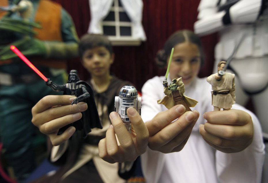 Pittsford,  N.Y.,  residents Chase Boss, left, 11, as Luke Skywalker and his twin sister, Sydney, as Princess Leia  hold Star Wars action figures, which were  inducted into the National Toy Hall of Fame at The Strong in Rochester, N.Y., on Nov. 15, 2012.