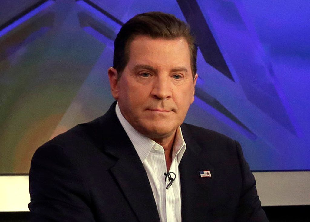 """In this July 22, 2015, file photo, co-host Eric Bolling appears on """"The Five"""" television program, on the Fox News Channel, in New York. Bolling is suing the reporter who broke the story that he allegedly sent lewd text messages to colleagues. Bolling filed a $50 million defamation lawsuit Wednesday against Yashar Ali, a Huffington Post contributing writer."""