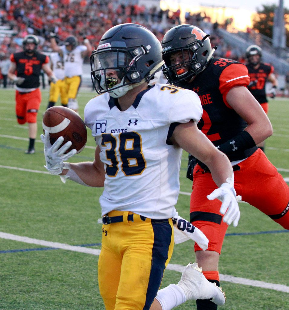 Highland Park's Hunter Heath (38) beats Rockwall defender Joseph Schaefer (32) to the end zone for the Scot's first touchdown during the first half of their high school football game at Wilkerson-Sanders Stadium in Rockwall on Friday, August 30, 2019. (John F. Rhodes / Special Contributor)