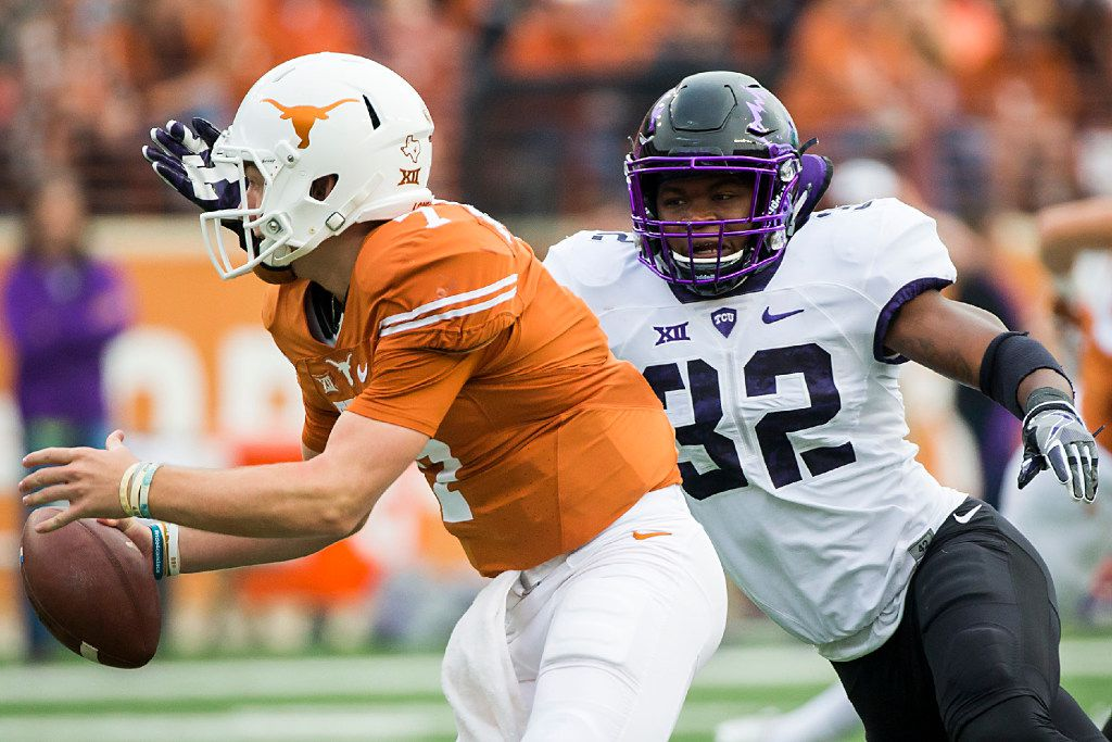 TCU linebacker Travin Howard (32) chases Texas quarterback Shane Buechele (7) from the pocket during the first half of an NCAA football game at Darrell K Royal ÐTexas Memorial Stadium on Friday, Nov. 25, 2016, in Austin.  (Smiley N. Pool/The Dallas Morning News