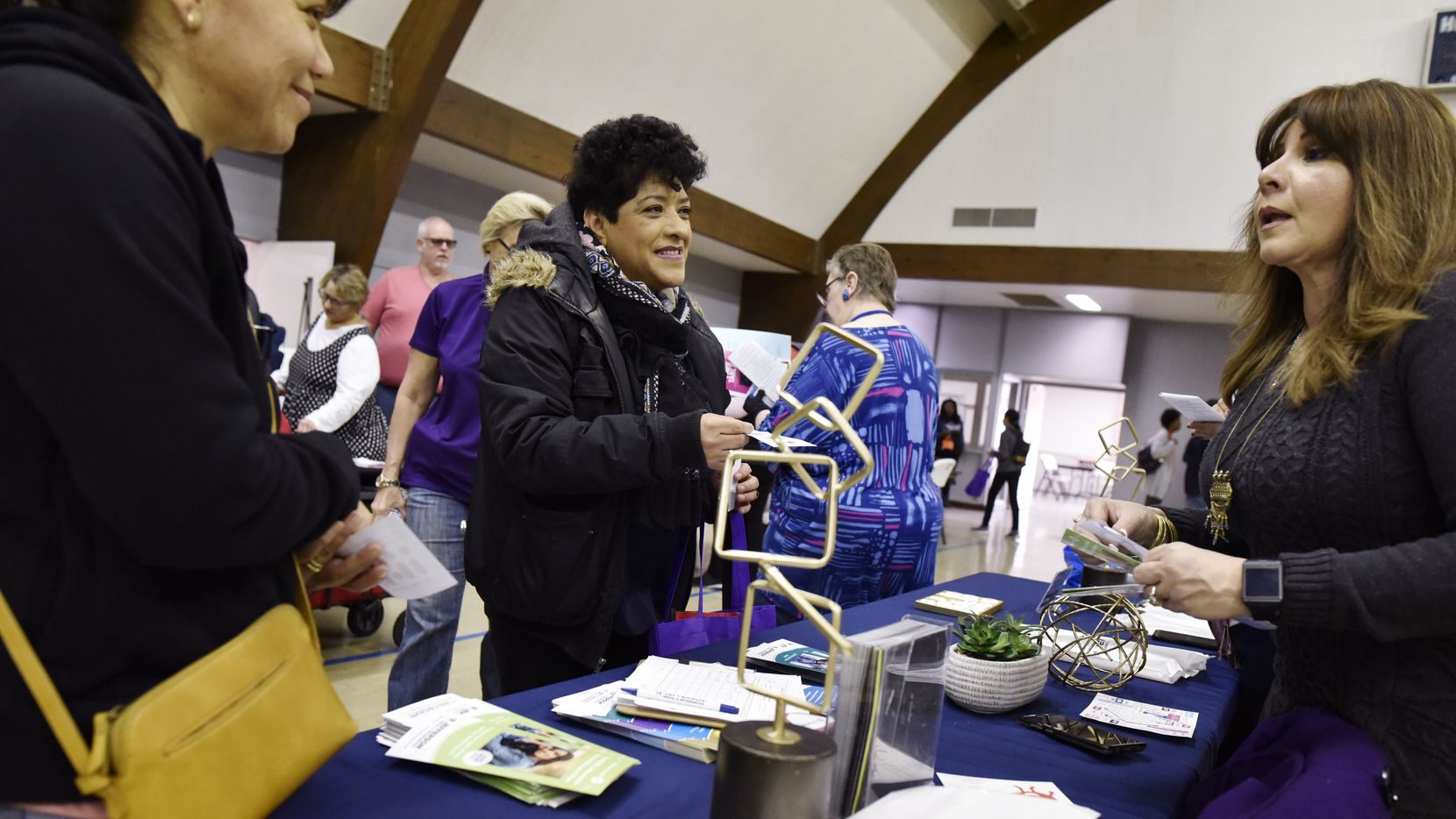 Laura Montoya, left, and Veronica Ocana, center, receive dental information from Jefferson Dental community manager Dely Acosta, right, during a health and safety fair at Pleasant Grove Christian Church in Dallas, Jan. 25, 2020. The fair hosted a variety of health and safety information, as well as free flu shots by the Dallas County Health Department, and free lab tests checking cholesterol, STDs, thyroid, diabetes and glucose levels. Ben Torres/Special Contributor
