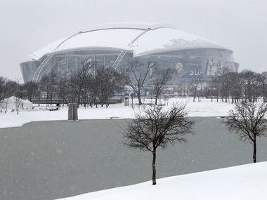 FILE — The parkS around Mark Holtz Lake and Cowboys Stadium, site of Super Bowl XLV, were covered in about 4 inches of snow that fell since overnight, Friday, February 4, 2011.