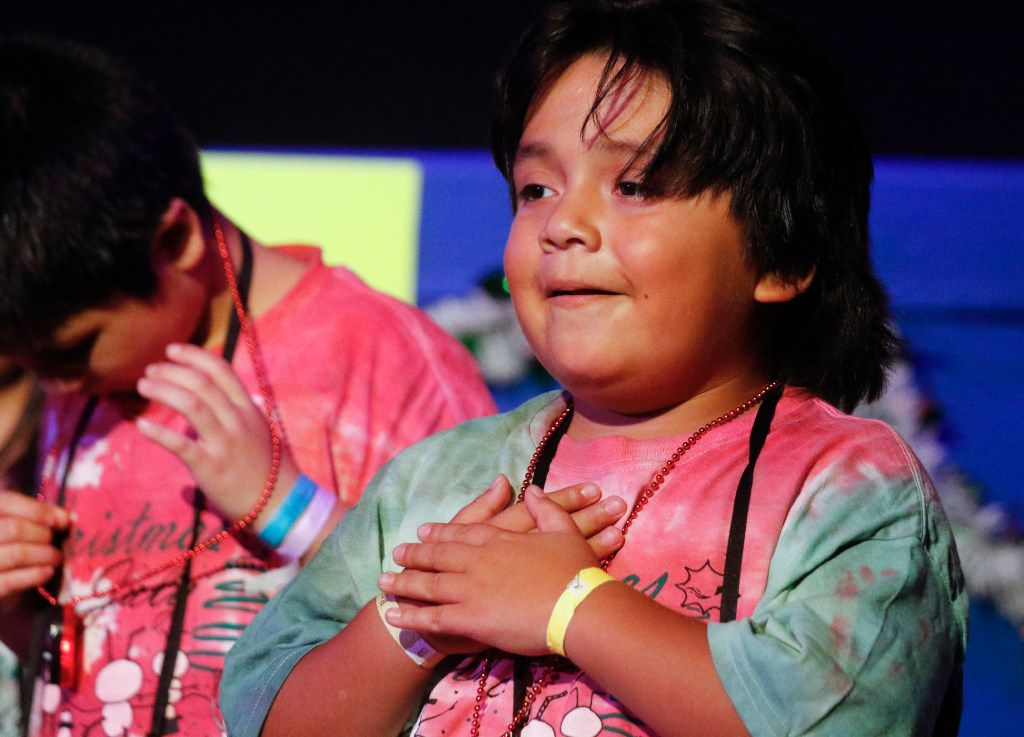 Matthew Rojas, 9, performs with fellow campers at Camp Bravo.