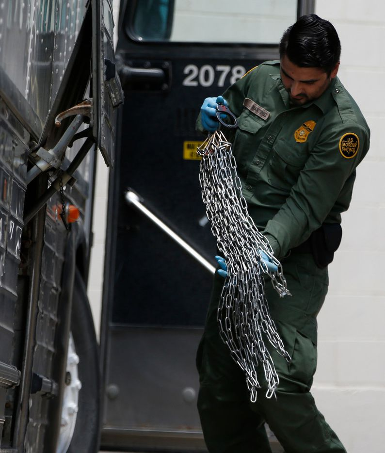 A U.S. Border patrol officer loads up chains and shackles at the federal courthouse in McAllen, Texas on June 11, 2018.