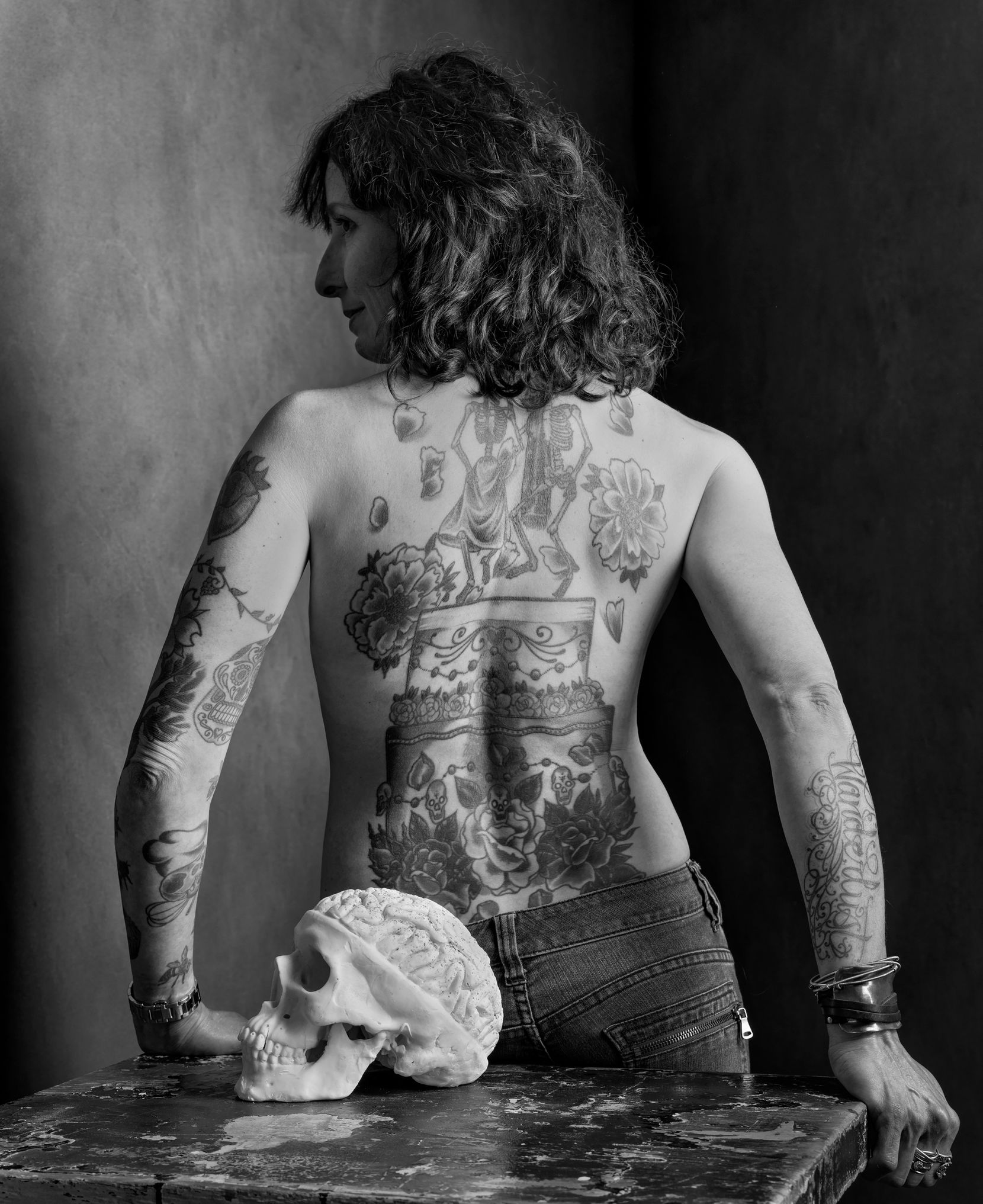 Pastry chef Katherine Clapner reveals her intricate back tattoos in this portrait.