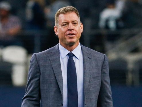 Troy Aikman walks the field prior to an NFL matchup between the Dallas Cowboys and the Los Angeles Rams on Sunday, Dec. 15, 2019 at AT&T Stadium in Arlington, Texas.