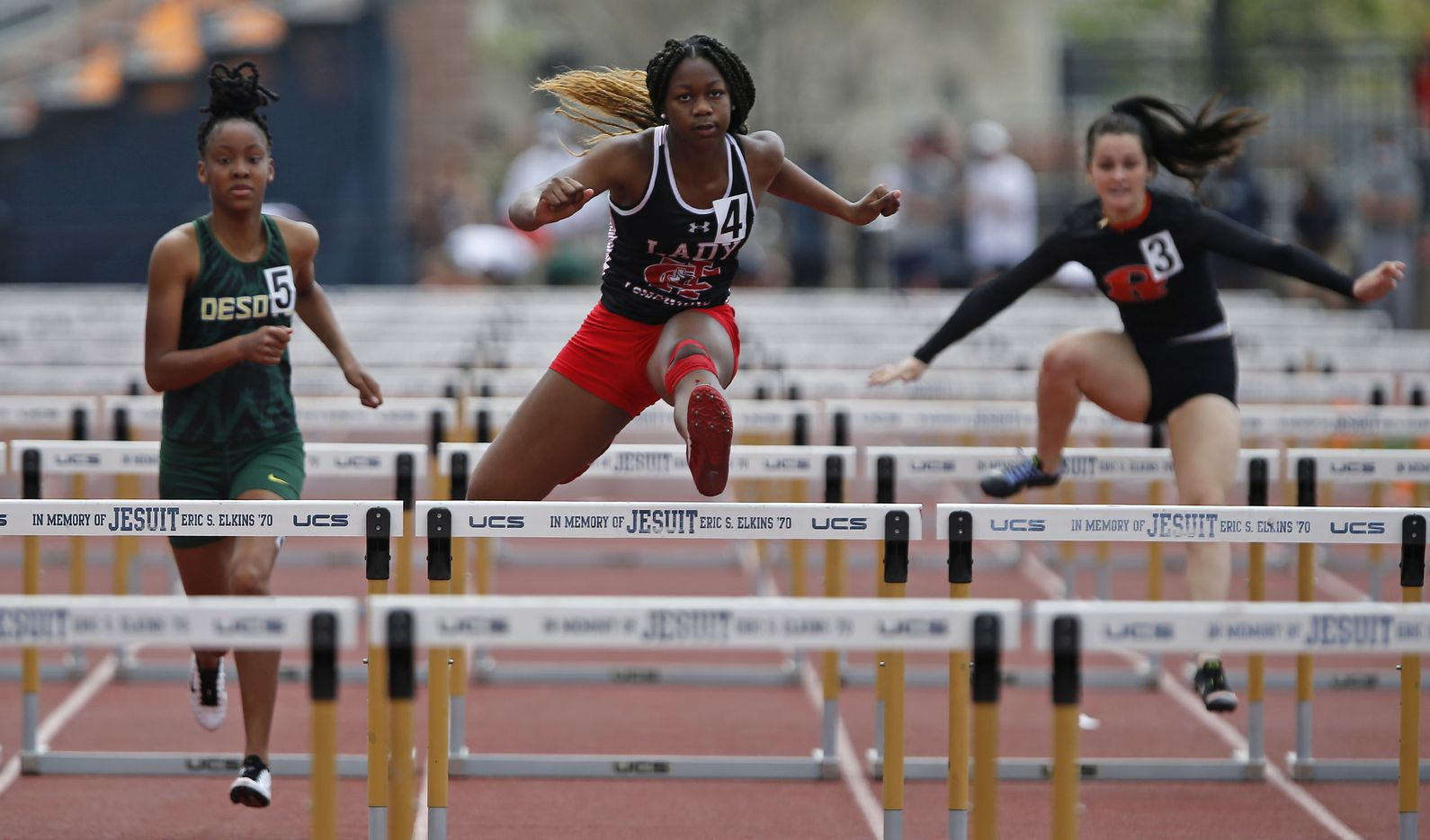 Cedar Hill High School's Charidee Morgan (center), 15, won her heat in the 100 hurdles during the Jesuit-Sheaner Relays held at Jesuit College Preparatory School in Dallas on Saturday, March 27, 2021.  (Stewart F. House/Special Contributor)