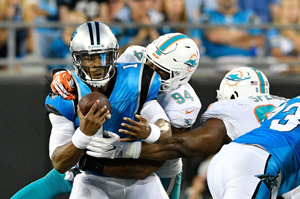 CHARLOTTE, NC - AUGUST 17:  Robert Quinn #94 of the Miami Dolphins sacks Cam Newton #1 of the Carolina Panthers in the second quarter during the game at Bank of America Stadium on August 17, 2018 in Charlotte, North Carolina.  (Photo by Grant Halverson/Getty Images)