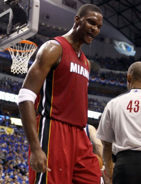 Miami Heat power forward Chris Bosh (1) reacts to dunking against the Dallas Mavericks in the second quarter during Game 3 of the NBA Finals at American Airlines Center Sunday, June 5, 2011 in Dallas.