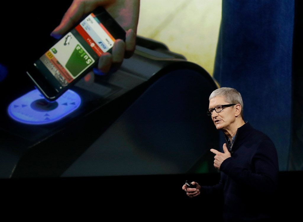 FILE - In this Thursday, Oct. 27, 2016, file photo, Apple CEO Tim Cook speaks during an announcement of new products, in Cupertino, Calif. Technology leaders are about to come face-to-face with President-elect Donald Trump after fiercely opposing his candidacy, fearful that he would stifle innovation, curb the hiring of computer-savvy immigrants and infringe on consumers' digital privacy. On Wednesday, Dec. 14, 2016, Silicon Valley luminaries and other technology leaders are headed to Trump Tower in New York to make their peace, or press their case, with Trump and his advisers. Cook is one of the CEOs planning to attend. (AP Photo/Marcio Jose Sanchez, File)