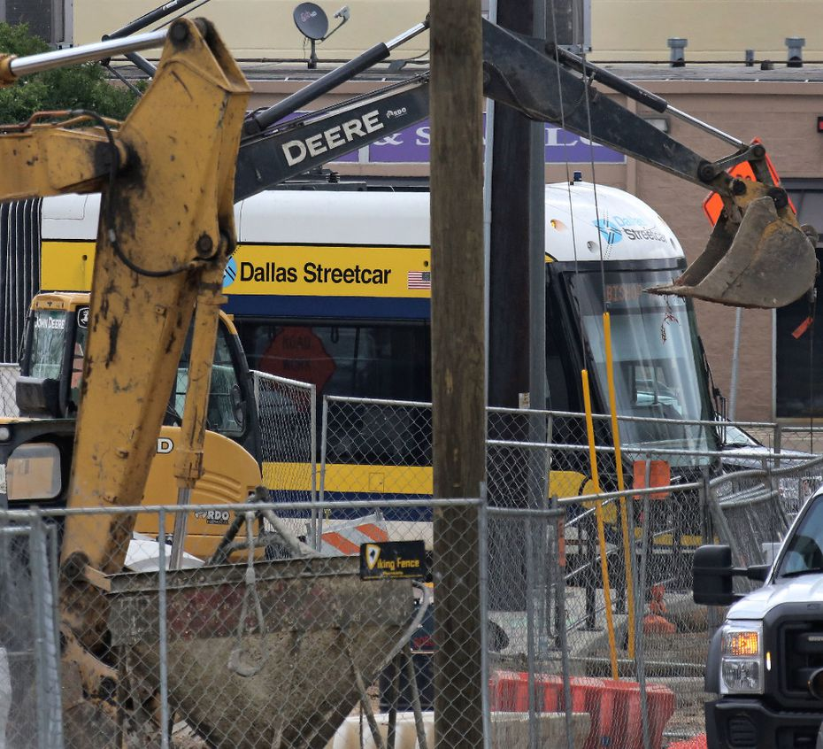 The Dallas streetcar is seen through a maze of construction at the Bishop Arts stop, photographed on Thursday, April 13, 2017. (Louis DeLuca/The Dallas Morning News)