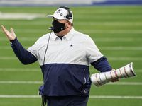 Cowboys head coach Mike McCarthy reacts after a call went against his team on a failed fourth-and-1 play during the second quarter of a game against Washington at AT&T Stadium on Thursday, Nov. 26, 2020, in Arlington.