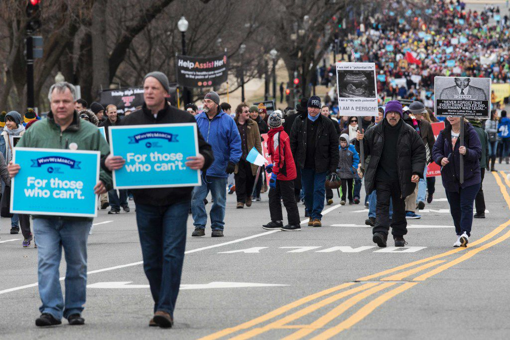 Pro-life protesters walk on Constitution Avenue towards the US Supreme Court during the 44th annual March for Life on January 27, 2017 in Washington, DC. Anti-abortion activists are gathering for the 44th annual March for Life in Washington, protesting the 1973 Supreme Court decision legalizing abortion.