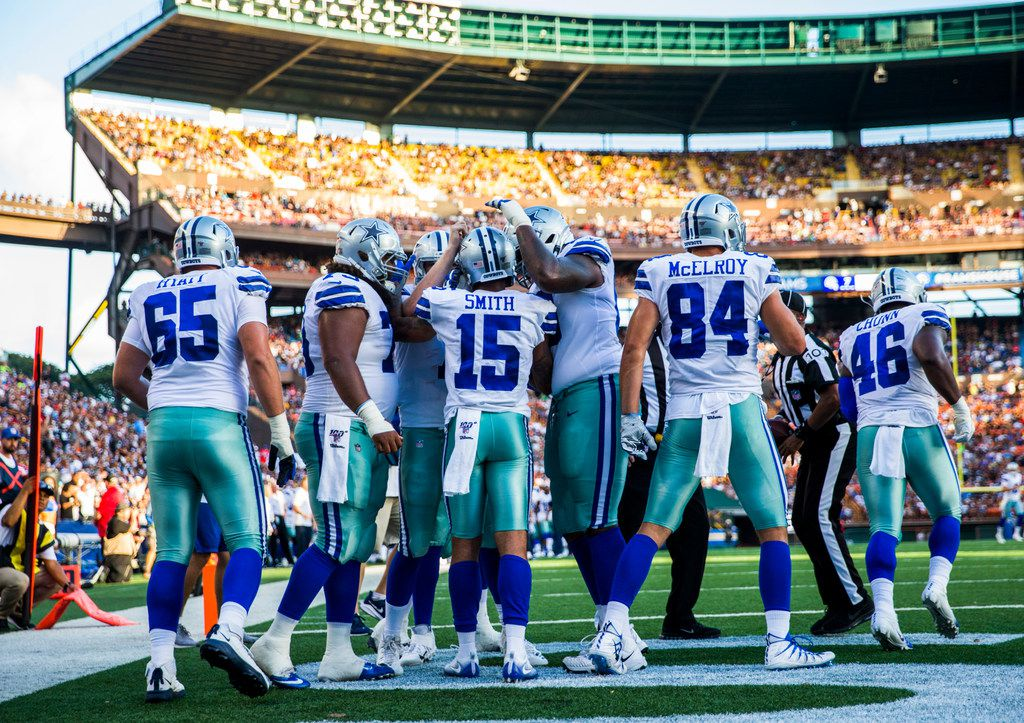 Dallas Cowboys celebrate with wide receiver Devin Smith (15) after he scored a touchdown during the third quarter of an NFL preseason game between the Dallas Cowboys and the Los Angeles Rams on Friday, August 17, 2019 at Aloha Stadium in Honolulu, Hawaii. (Ashley Landis/The Dallas Morning News)