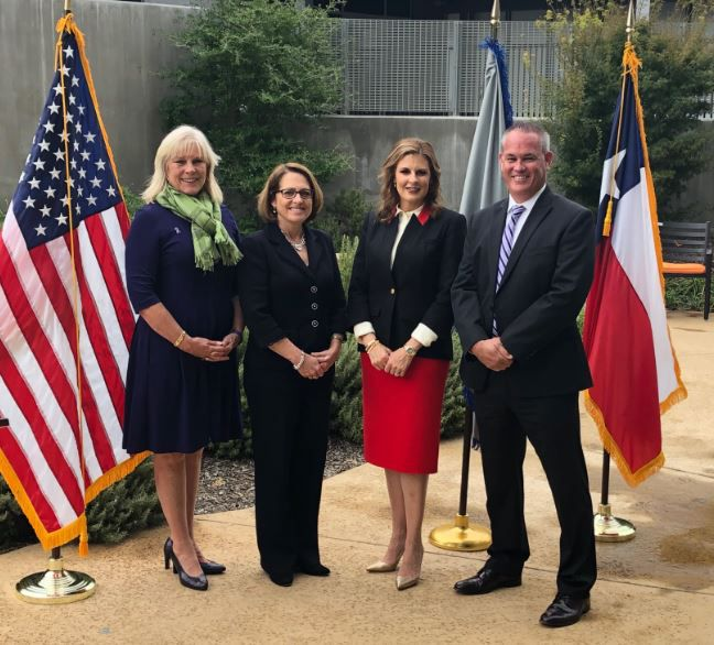 The Family Place in Dallas hosted Tuesday's announcement, attended by (from left) shelter CEO Paige Flink; Laura L. Rogers, acting director of the Department of Justice's Office on Violence Against Women; U.S. Attorney Erin Nealy Cox; and Jeffrey C. Boshek II, special agent in charge of the Bureau of Alcohol, Tobacco, Firearms and Explosives in Dallas.