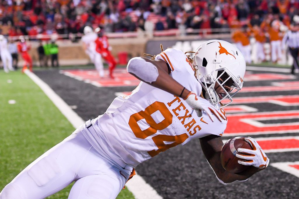 LUBBOCK, TX - NOVEMBER 10: Lil'Jordan Humphrey #84 of the Texas Longhorns falls across the goal line and scores the winning touchdown with seconds left in the fourth quarter against the Texas Tech Red Raiders on November 10, 2018 at Jones AT&T Stadium in Lubbock, Texas. Texas defeated Texas Tech 41-34. (Photo by John Weast/Getty Images)
