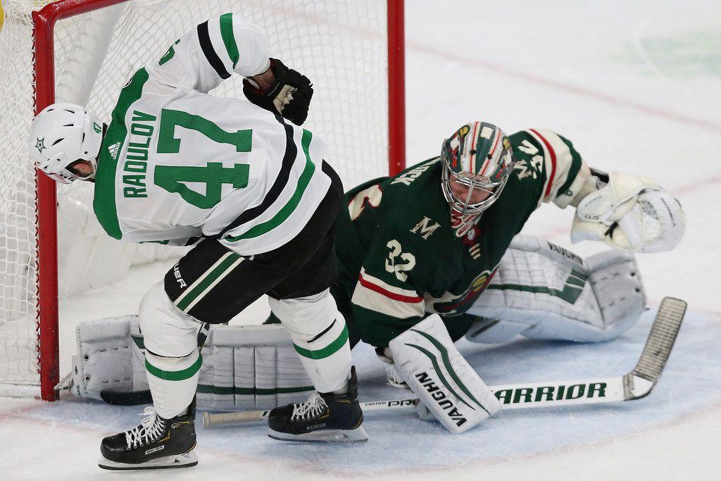 Minnesota Wild's goalie Alex Stalock, right, blocks a shot by Dallas Stars' Alexander Radulov, left, of Russia, in a shootout in an NHL hockey game Sunday, Dec. 1, 2019, in St. Paul, Minn. (AP Photo/Stacy Bengs)