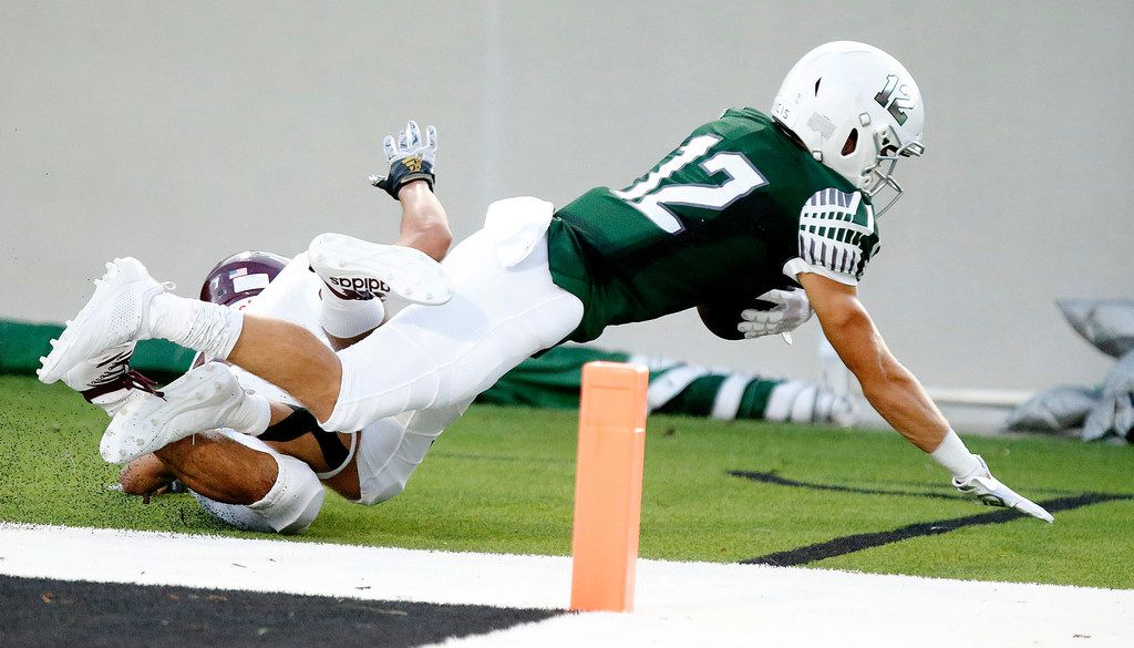 Prosper High School wide receiver Hayden Metcalf (12) catches a trouchdown pass during the first half as Prosper High School hosted Rowlett High School in a non-district football game at Children's Health Stadium in Prosper on Friday, August 30, 2019. (Stewart F. House/Special Contributor)