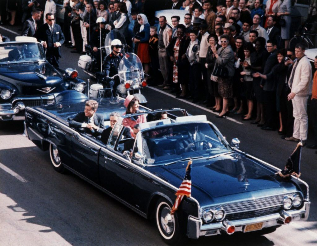 President John F. Kennedy and first lady Jacqueline Kennedy riding through Dallas in the presidential motorcade in 1963, moments before the assassination.