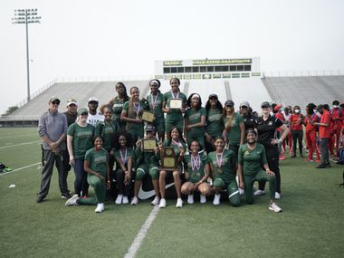 The DeSoto girls celebrate winning the team championship at the District 11-6A meet Friday. DeSoto won all three relays and four individual events.
