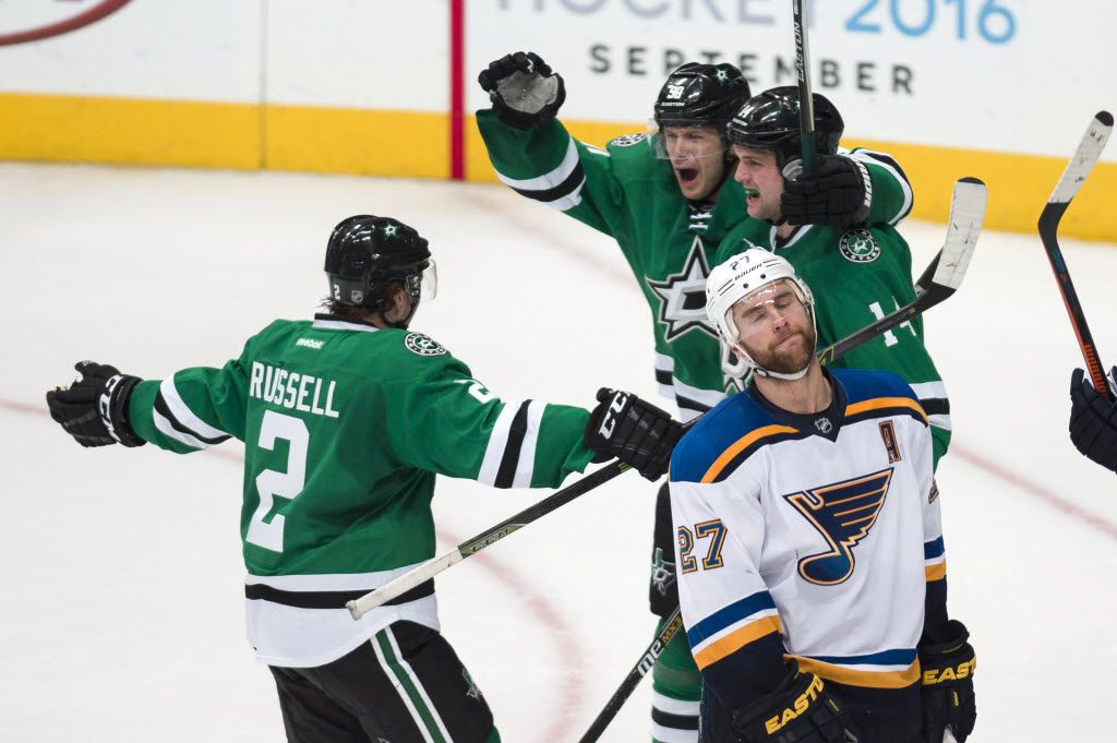 Mar 12, 2016; Dallas, TX, USA; Dallas Stars defenseman Kris Russell (2) and left wing Jamie Benn (14) and center Jason Spezza (90) celebrate Benn's game tying goal during the third period as St. Louis Blues defenseman Alex Pietrangelo (27) looks on at the American Airlines Center. The Blues defeat the Stars 5-4 in overtime. Mandatory Credit: Jerome Miron-USA TODAY Sports