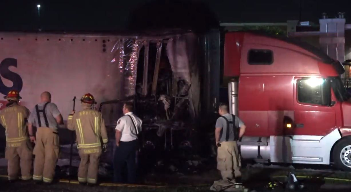 Fire crews survey a damaged section of an 18-wheeler that caught fire Wednesday morning in North Richland Hills.