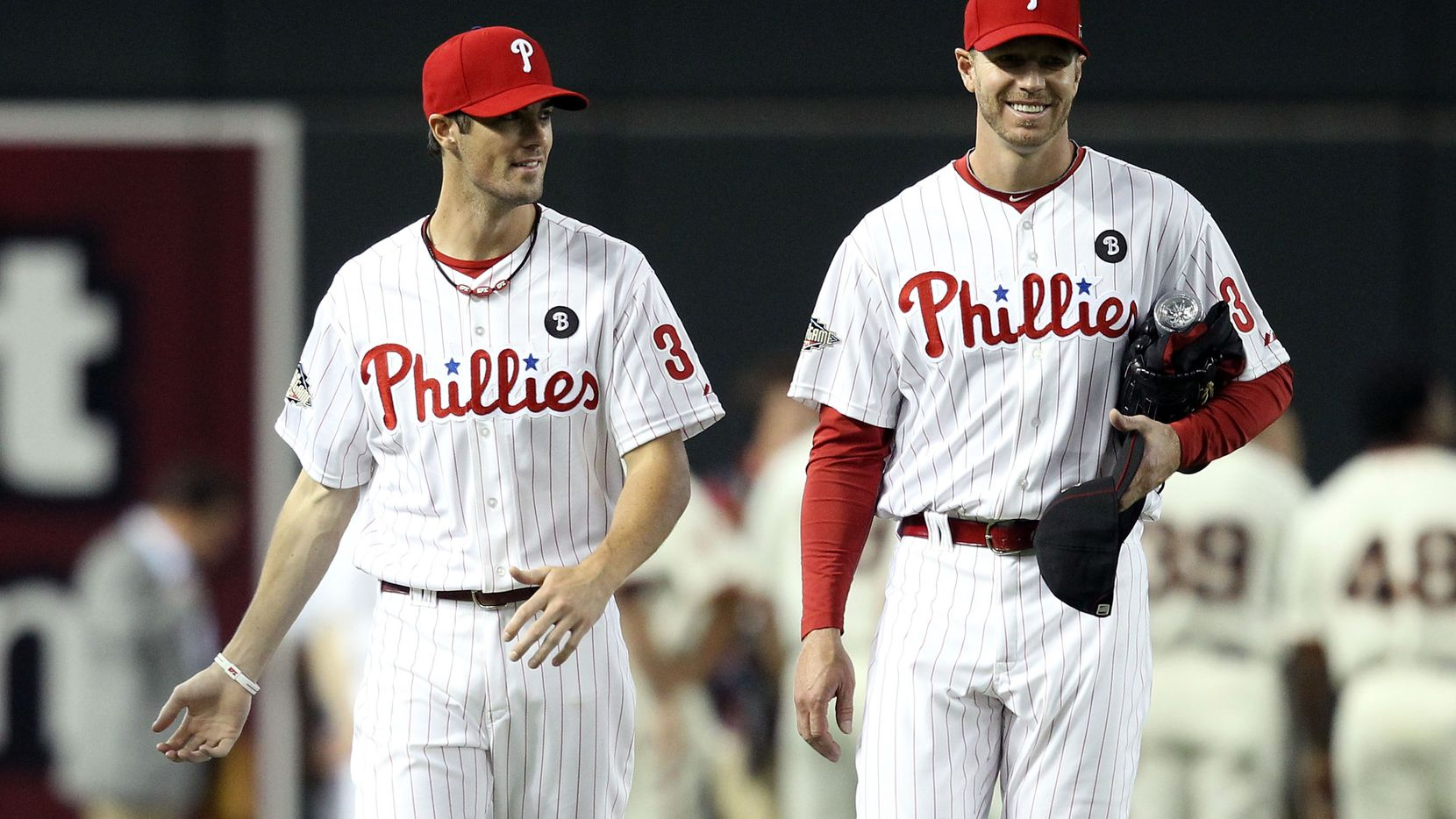 PHOENIX, AZ - JULY 12:  National League All-Star Cole Hamels #35 of the Philadelphia Phillies and National League All-Star Roy Halladay #34 of the Philadelphia Phillies talk during batting practice before the start of the 82nd MLB All-Star Game at Chase Field on July 12, 2011 in Phoenix, Arizona.  (Photo by Christian Petersen/Getty Images)