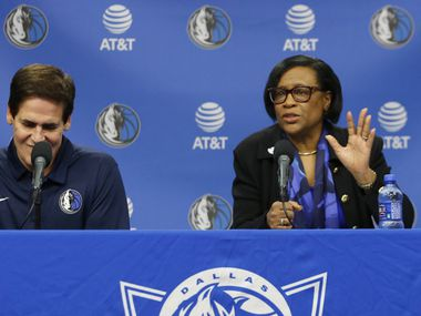 Dallas Mavericks interim CEO Cynthia Marshall addresses the room next to Dallas Mavericks owner Mark Cuban during a press conference at American Airlines Center in Dallas on Monday, February 26, 2018.