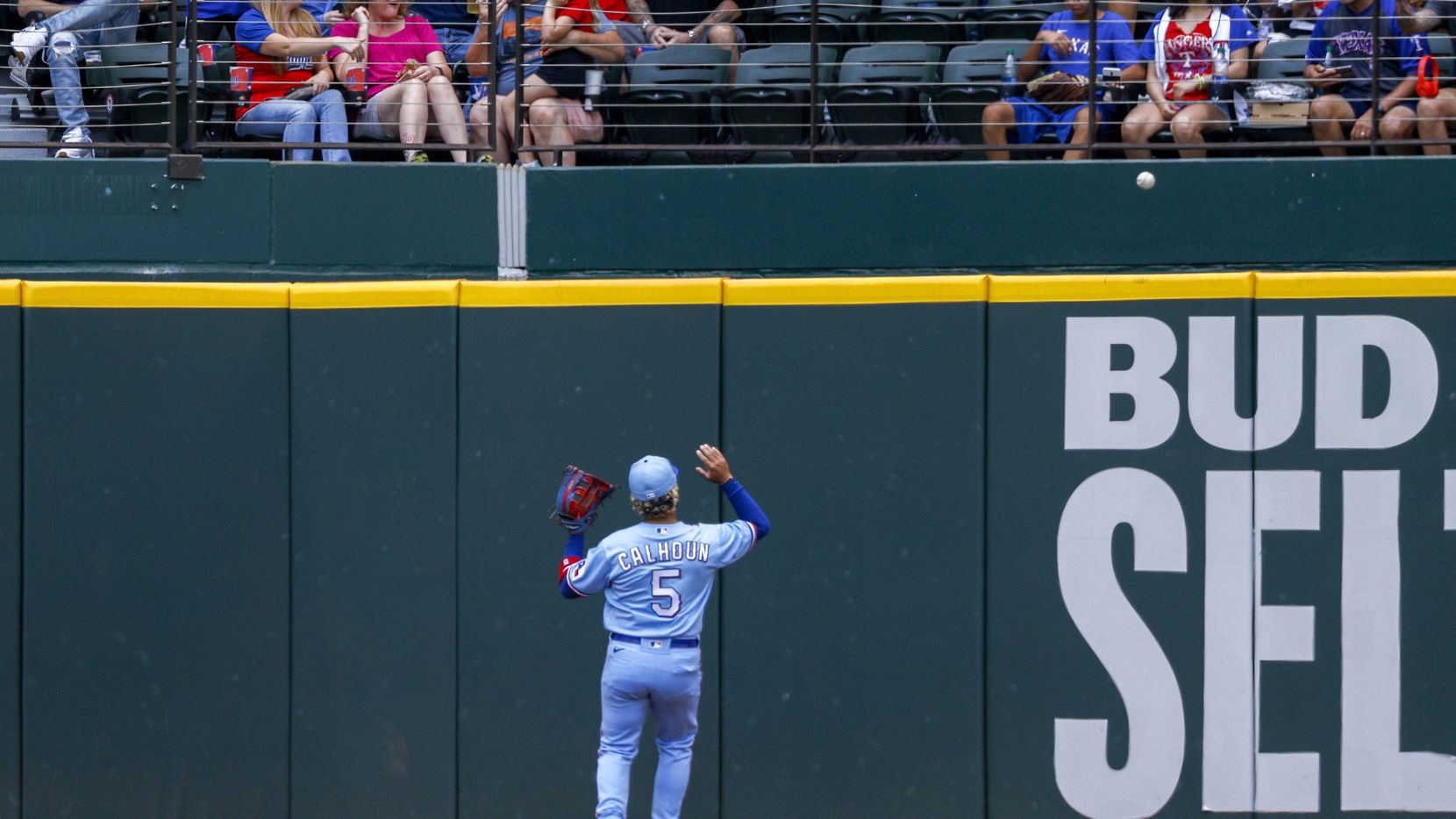 Texas Rangers left fielder Willie Calhoun (5) reacts to a ground rule double by Cleveland Indians left fielder Oscar Mercado (35) during the third inning of a game against the Cleveland Indians at Globe Life Field on Sunday, Oct. 3, 2021, in Arlington.