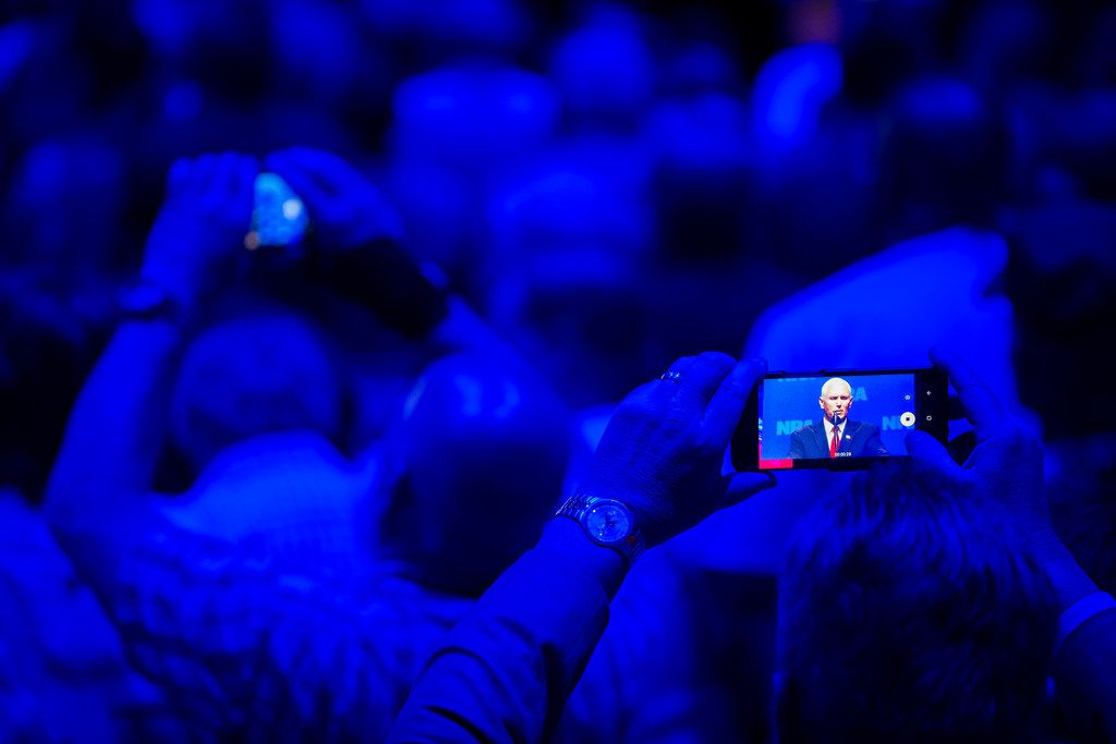 Audience members train their phones on Vice President Mike Pence as he addresses the NRA-ILA Leadership Forum at the Kay Bailey Hutchison Convention Center on Friday, May 4, 2018, in Dallas.