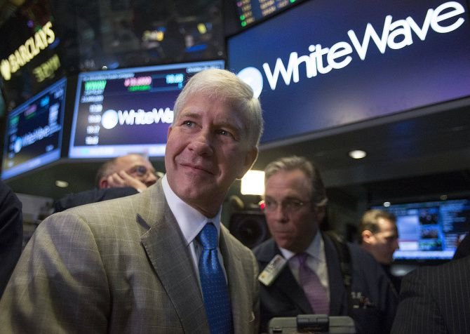 Gregg Engles stepped down as chairman of Dean Foods to focus on the spinoff company WhiteWave Foods.