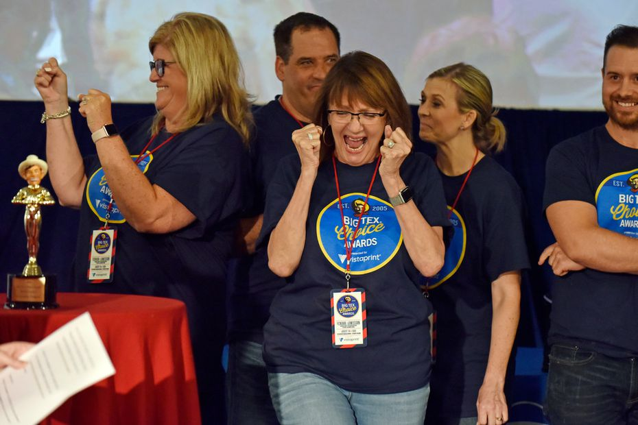 "Christi Erpillo, center, reacts as her family's fried hoppin' John cake is announced as a winner of the Big Tex Choice Awards at the State Fair of Texas. It was picked ""best taste - savory."""