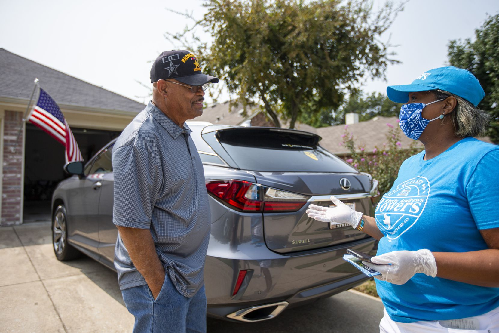 Incumbent State Representative, Democrat, Rhetta Bowers, right, wears a mask and gloves to speak with constituent Dalton Page while block walking in Rowlett Saturday, September 19, 2020. (Brandon Wade/Special Contributor)