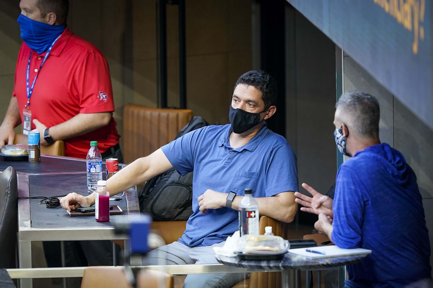 General Manager Jon Daniels (center) watches  an intrasquad game from a field level suit during Texas Rangers Summer Camp at Globe Life Field on Friday, July 17, 2020.