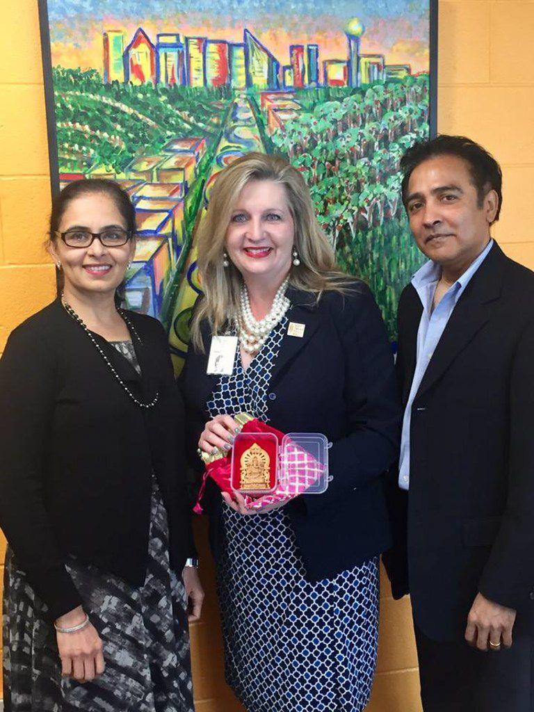 Aradhana Asava (from left), North Texas Food Bank CEO Trish Cunningham and Raj G. Asava.