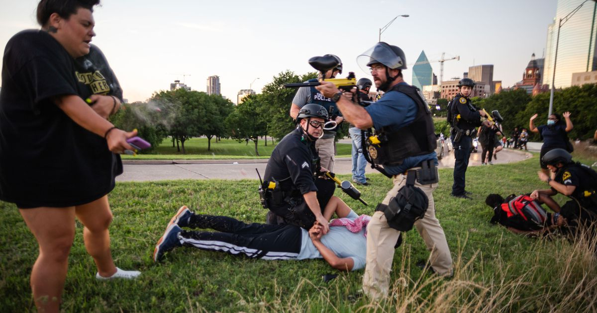 Dallas police Sgt. Roger Rudloff fires pepper balls at a protester (left) standing only a few feet away. The incident occurred just before dusk on May 30 during protests sparked by George Floyd's death.