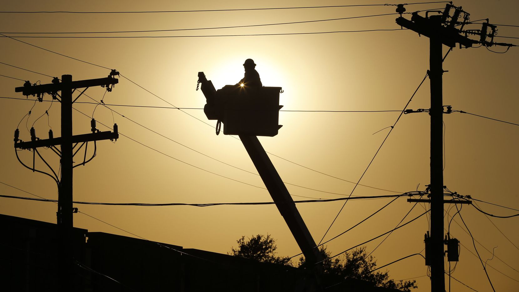 A Primoris lineman helped restore power near the intersection of Marsh and Walnut Hill Lanes in Dallas in October 2019 after tornadoes tore through the area.