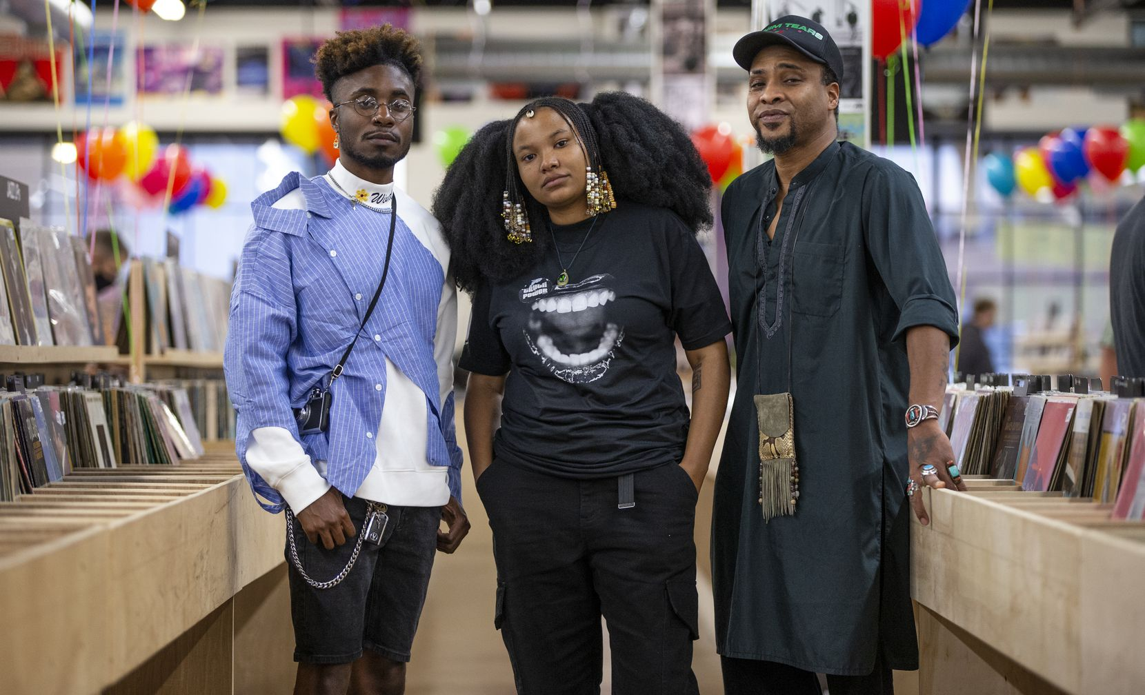 Truth To Power artists Cameron McCloud (left), Flower Child (center) and Keite Young pose for a photo at Josey Records on Saturday.
