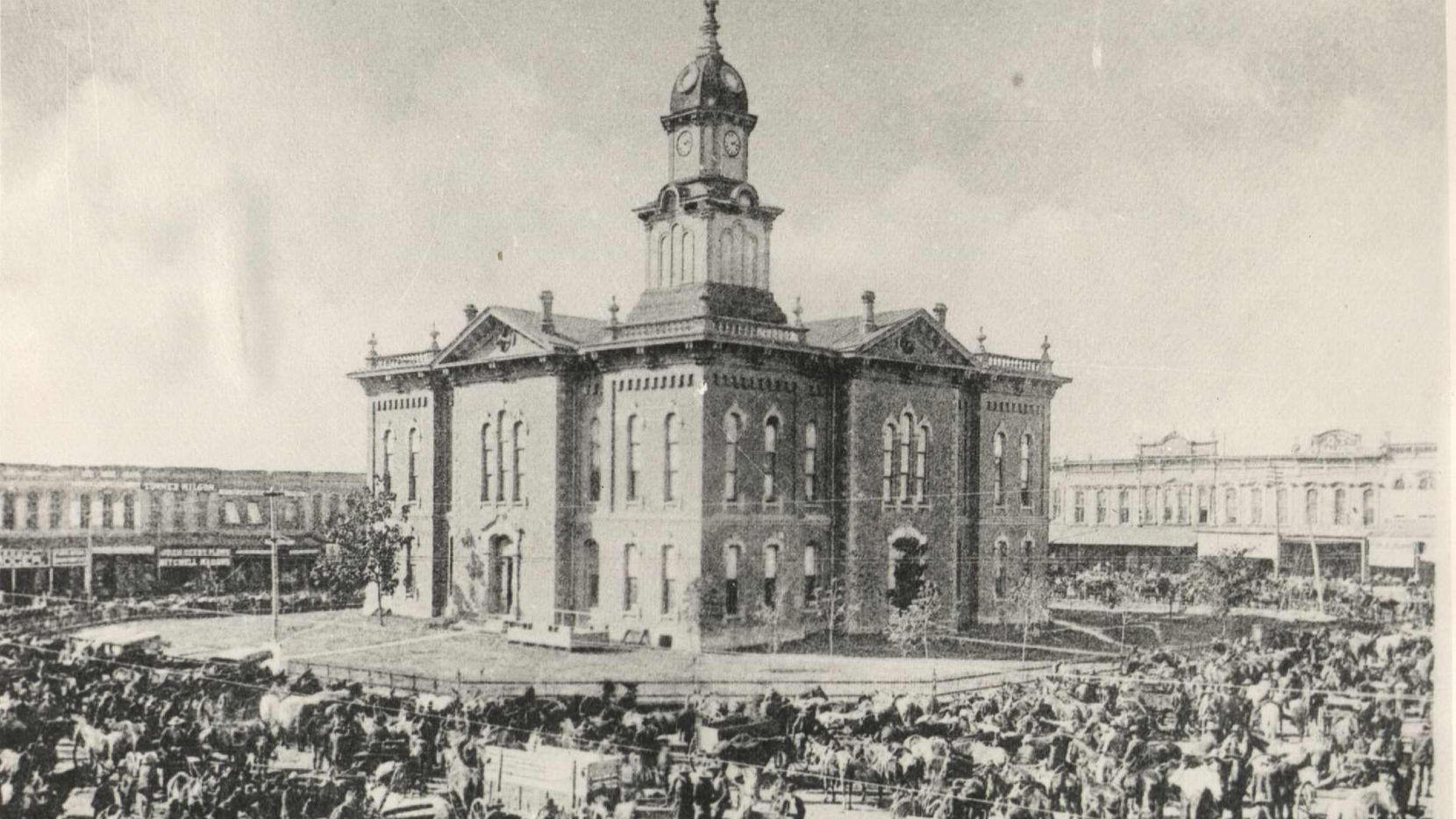 The Grayson County courthouse in 1880 before it was burned by a lynch mob in 1930. A group is campaigning to install a historical marker on the grounds to commemorate that event and its victim.